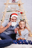 Portrait of happy daughter and father in christmas time - 230628505