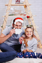 """Постер, картина, фотообои """"Portrait of happy daughter and father in christmas time"""""""