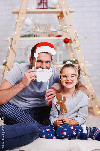 Portrait of happy daughter and father in christmas time © gpointstudio