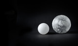 Two spheres covered with frosty pattern.
