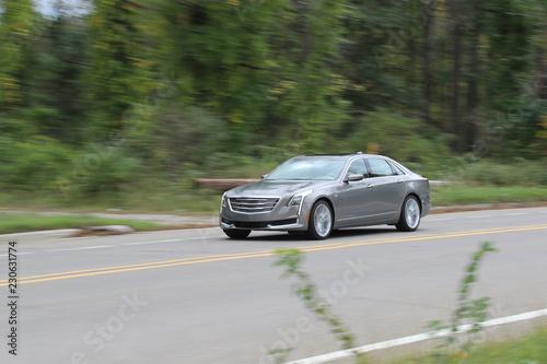 Luxury Sedan Traveling Down The Road