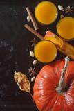 Fresh pumpkin juice with cinnamon on dark background - 230632723
