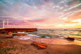 Bright colorful sunrise at the pier by the sea.  - 230638309