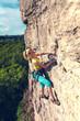 Leinwandbild Motiv The girl climbs the rock.