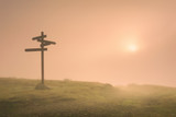 signpost in the mountain at foggy morning - 230652527