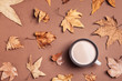Leinwanddruck Bild - Flat lay composition with hot cozy drink and autumn leaves on color background