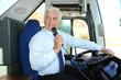 Leinwanddruck Bild - Professional driver making announcement for passengers in bus