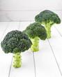 Three broccoli onthe wood