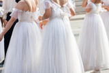 Group ballerinas in white dress await street classical modern ballet dance performance - 230660394
