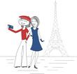 Two women take pictures of themselves with a mobile phone in Paris in front of the Eiffel Tower