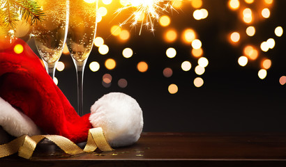 Christmas and happy New year party background; champagne and Santa hat