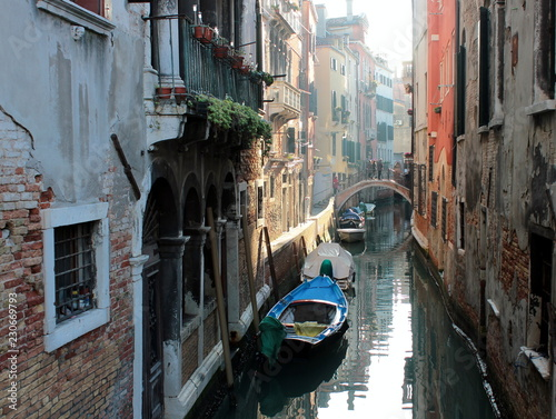 The canal in Venice. Ancient buildings, bridges, boats, reflections in the water - 230669793