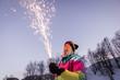 Leinwanddruck Bild - Woman holding a sparkler fireworks