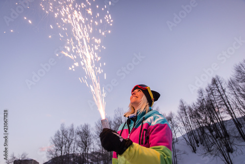 Leinwanddruck Bild Woman holding a sparkler fireworks