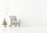 Living room interior wall mock up with grey tufted armchair, fur pillow and decorated christmas tree on empty white background. 3D rendering. - 230673957