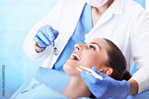 obraz PCV Adult woman having a visit at the dentist's