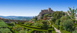 Leinwanddruck Bild - Marvao Castle on top of cliff with Alto Alentejo landscape in Portugal. Medieval Moorish fort or fortress and box hedge garden. Summer blue sky