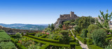 Marvao Castle on top of cliff with Alto Alentejo landscape in Portugal. Medieval Moorish fort or fortress and box hedge garden. Summer blue sky - 230678348