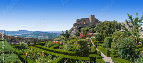 Leinwanddruck Bild Marvao Castle on top of cliff with Alto Alentejo landscape in Portugal. Medieval Moorish fort or fortress and box hedge garden. Summer blue sky
