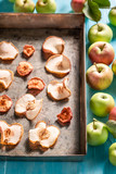 Sweet dried apples on old baking tray