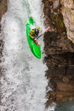 Whitewater kayaking down falls at Beauty Creek near Jasper, Alberta Canada