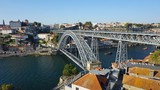 douro river in porto with dom luis bridge and houses