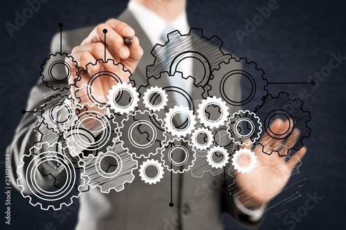 Leinwanddruck Bild Businessman and analytics symbols on grey background