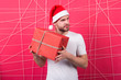 Leinwandbild Motiv online christmas shopping. Happy new year. happy santa man. The morning before Xmas. man in santa hat hold christmas present. delivery christmas gifts. Christmas fun. Capturing a happy moment