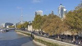 A footpath by a riverside with a row of trees. London in autumn. - 230713719