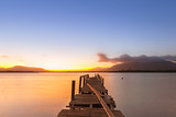 sunrise on the sea view from wooden jetty and blue sky