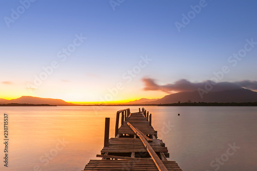 Acrylglas Pier sunrise on the sea view from wooden jetty and blue sky