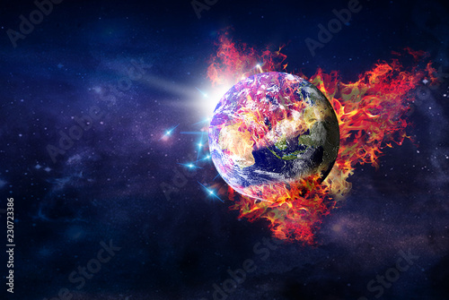 flying burning globe planet Earth in outer space.elements of this image furnished by NASA