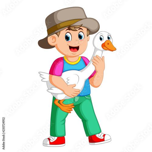 a Farm boy holding a goose - 230724952