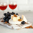 Brie cheese or Camembert with grapes