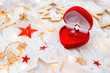 Christmas and New Year holiday background with decorations and engagement ring with diamond in gift heart box.