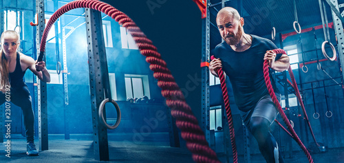 Wall mural Collage about man and woman with battle rope during exercise in the fitness gym. Gym, sport, rope, training, athlete, workout, exercises concept