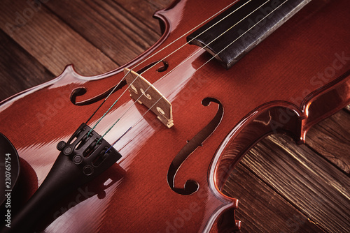 violin  on an old wooden background