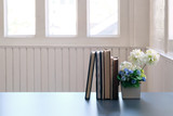 Books and flower on table with copy space. - 230766142