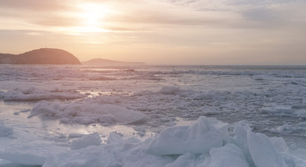 Frozen sea view at sunset.