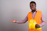 Young African man construction worker showing something  - 230772776