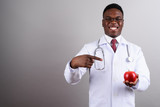 Young African man doctor against white background