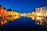 View of center of Alesund, Norway at night with reflection in the river - 230810389