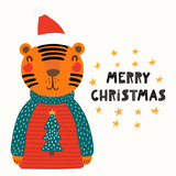 Hand drawn vector illustration of a cute funny tiger in a Santa hat, sweater, with text Merry Christmas. Isolated objects on white background. Scandinavian style flat design. Concept for card, invite.