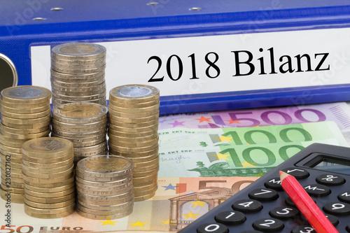 Leinwanddruck Bild 2018 Bilanz / Ordner mit Geld