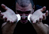 Upset handcuffed man imprisoned for crime, punished for serious villainy.. Arrest, gangster, pain concept. - 230837137