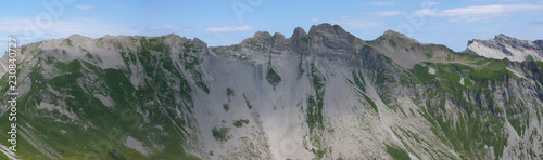 Leinwanddruck Bild panorama mountain landscape of the Raetikon mountains in the Alps of Switzerland