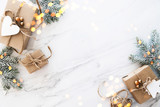 Christmas and New Year holiday background. Xmas greeting card. Christmas gifts on white marble background top view. Flat lay - 230860119