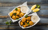 Fried cauliflower in batter with a savory sauce of cashew nuts. healthy vegan fast food. Baked Buffalo Cauliflower
