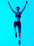 one mixed races woman exercsing fitness exercices jumping happy  isolated on blue blackground - 230870514