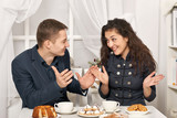 romantic couple drinking tea with cookies and talking - 230883902